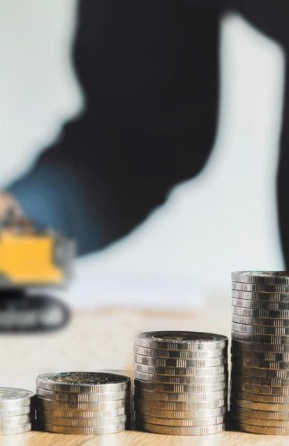 Schodki z monet symbolizujące koszta prac